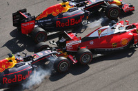 Formula 1 Photos - Daniil Kvyat, Red Bull Racing RB12 crashes into Sebastian Vettel, Ferrari SF16-H at the start