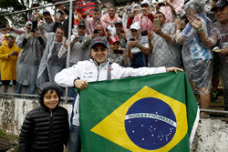 Felipe Massa, Williams, and son Felipinho, with fans and the Brazilian flag