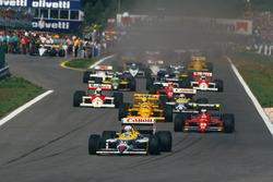 Nigel Mansell, Williams FW11B Honda, leads Gerhard Berger, Ferrari F187, Ayrton Senna, Lotus 99T Honda, Nelson Piquet, Williams FW11B Honda, and Alain Prost, McLaren MP4/3 TAG Porsche, at the start