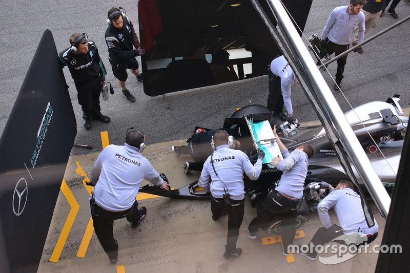 Mercedes AMG F1 mechanic at work on the rear wing