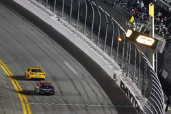 Kyle Busch, Joe Gibbs Racing Toyota takes the checkered flag under caution