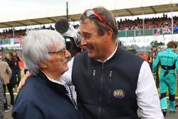 Bernie Ecclestone, with Nigel Mansell, FIA Steward on the grid