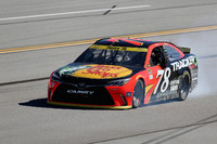 NASCAR Sprint Cup Photos - Martin Truex Jr., Furniture Row Racing Toyota with a blown engine