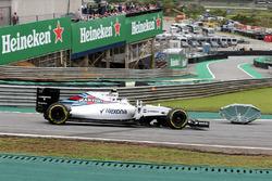 Valtteri Bottas, Williams FW38 avoids an umbrella on track