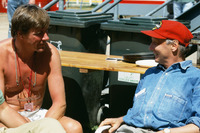 Formula 1 Photos - Former World Champions, James Hunt and Niki Lauda chat in the paddock