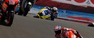 Rossi takes US GP as Stoner stumbles