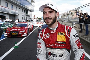 Two Audi RS 5 DTM cars on second row of the grid