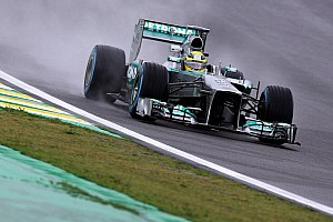 Rosberg retains top spot in rainy Brazil's second practice