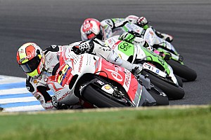 MotoGP Race report Yonny Hernandez celebrates his fiftieth race finishing seventh, his best result in MotoGP