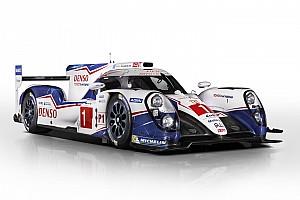 Toyota unveils 2015 car, signs Kobayashi