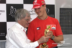 Michael Schumacher receive his 'Bernie' from Bernie Ecclestone