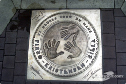 The commemorative plaque embedded into the pavement for the 2000 victory on Place St. Nicolas in Le Mans