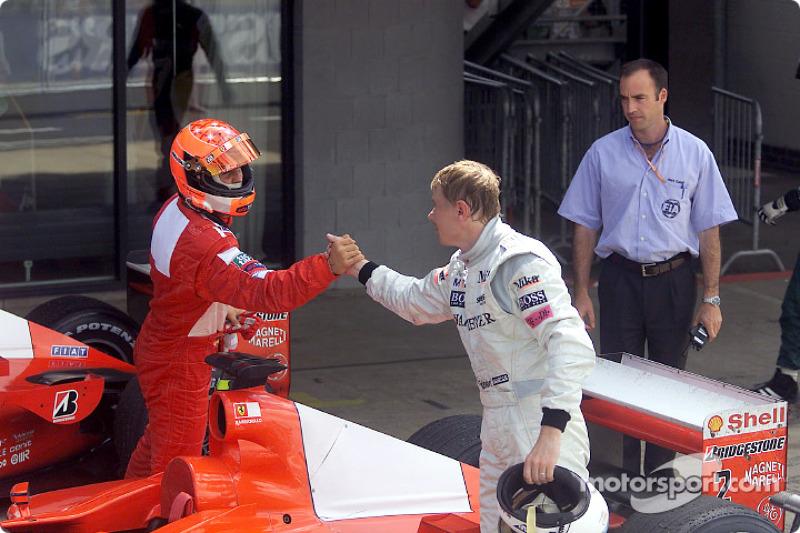Mika Hakkinen and Michael Schumacher shaking hands