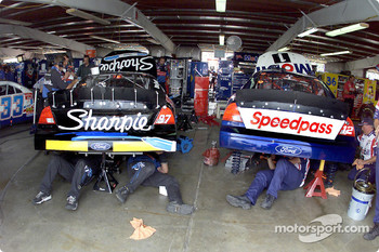 The Fords of Kurt Busch and Jeremy Mayfield share a garage stall at Watkins Glen