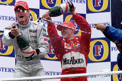 The podium: David Coulthard and Michael Schumacher
