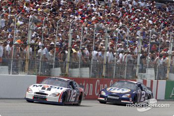 Jeremy Mayfield and Rusty Wallace race down the front stretch