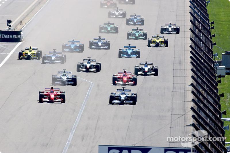 The start: Michael Schumacher and Juan Pablo Montoya side by side