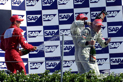 The podium: champagne shower for Mika Hakkinen