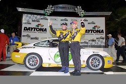 Shelby Wellman and David Haskell wave from Daytona's Victory Lane after winning the Grand-Am Cup finale