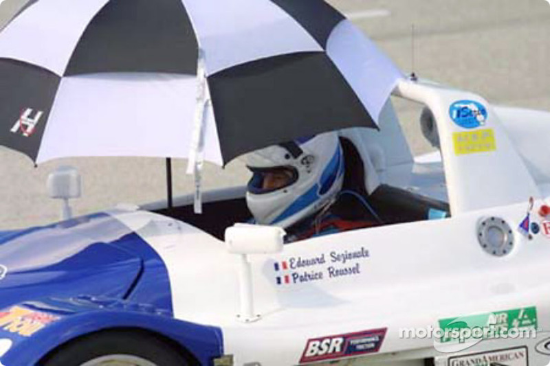 The Sezio Florida Racing Team driver seeks refuge from the sun before the start