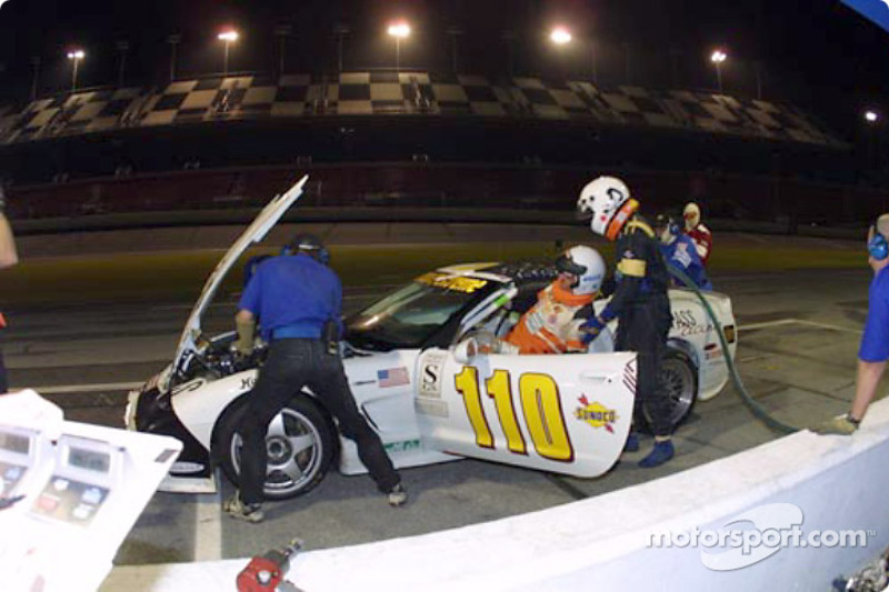 Frank Del Vecchio is helped into the #110 Powell Motorsports Corvette by his co-driver at the Grand-Am Finale