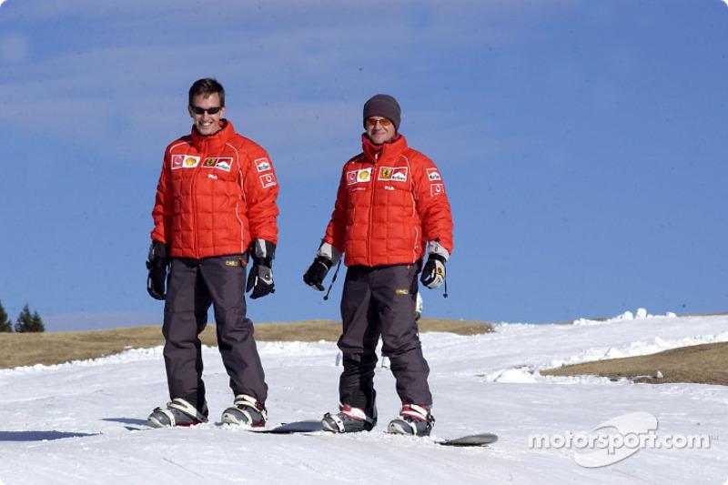 Luciano Burti and Rubens Barrichello on snowboard