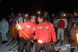 Michael Schumacher and Luca Badoer in the torch-light sky run