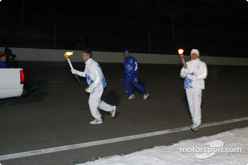 Eddie Cheever begins his leg of the Olympic Torch journey