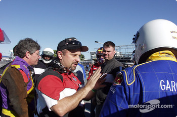 Phil Clements conducts a drivers meeting before racers hit the high banks of Daytona International Speedway