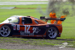 The #12 Ultima GTR belches flames as it tries to restart after spinning in the chicane in the early stages of the Rolex 24 at Daytona