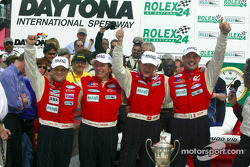 The winning team: Mauro Baldi, Didier Theys, Fredy Lienhard and Max Papis celebrate in Victory Lane after winnning the Rolex 24 At Daytona