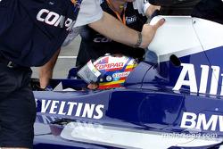 Juan Pablo Montoya being pushed back in the garage