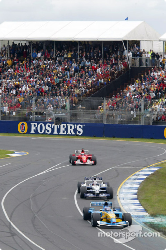 Jarno Trulli in front of Juan Pablo Montoya and Michael Schumacher