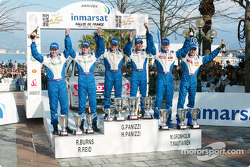 Podium: winners Hervé and Gilles Panizzi with second Marcus Gronholm and Timo Rautiainen, and third Richard Burns and Robert Reid