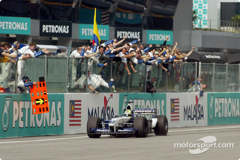 Ralf Schumacher taking the checkered flag