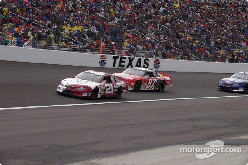 Joe Nemechek and Jeff Green warming the track