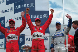 The podium: race winner Michael Schumacher with Rubens Barrichello and Ralf Schumacher