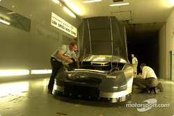 Visit to the wind tunnel at Lockheed Martin in Marietta, Georgia: crew members of the Wood Brothers team setup a Ford Taurus in readiness for the Wind Tunnel