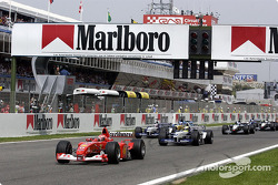 The start: Michael Schumacher taking the lead in front of Ralf Schumacher