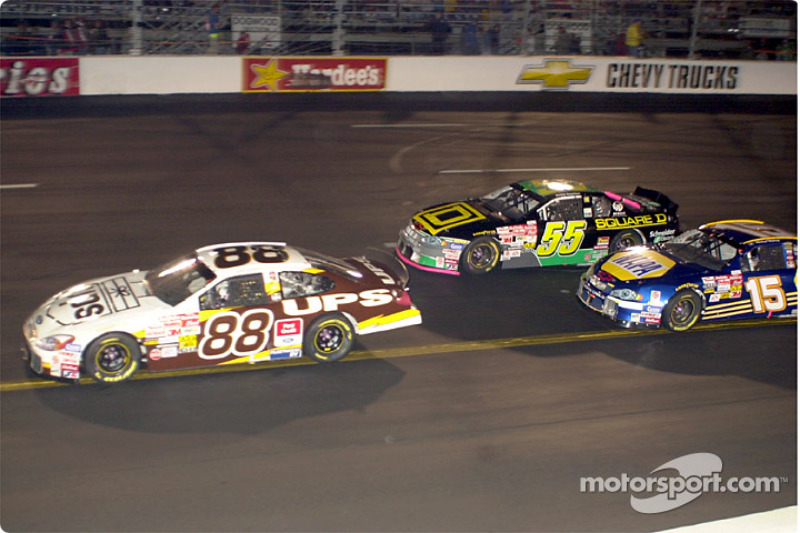 Dale Jarrett make his move for the lead right before the race is red flagged for the night after 66 laps
