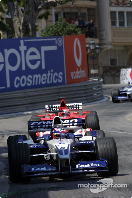 Juan Pablo Montoya in front of Michael Schumacher