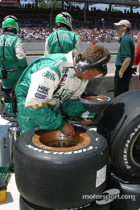 Team Green crew member checking tires