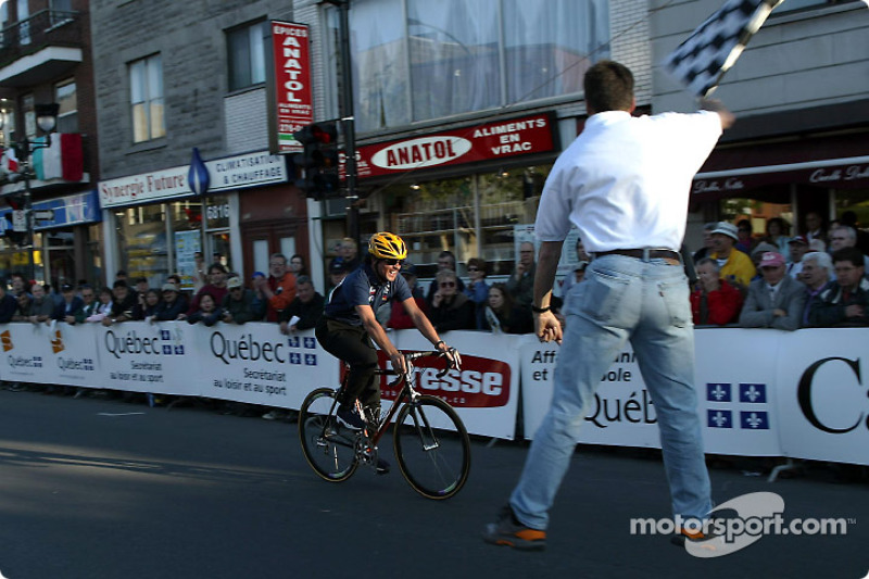 Sauber Petronas team manager Beat Zehnder participating in the celebrity Cycling race; he finished third