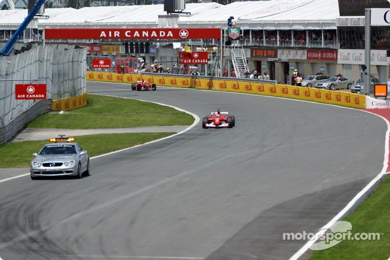 Rubens Barrichello behind the safety car