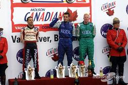 The podium: race winner Dario Franchitti with Paul Tracy and Tony Kanaan