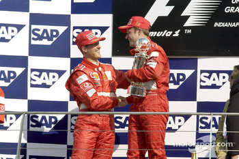 The podium: race winner Rubens Barrichello and Michael Schumacher