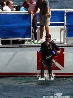 Four-Time NASCAR Winston Cup Champion Jeff Gordon enters the water at Biscayne National Park as he begins an underwater scuba diving trip with the South Florida media