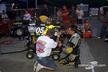 Kery Parnell and his crew work on his kart during a break in racing segments