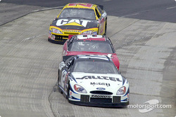The action gets tight even during happy hour: Ryan Newman ahead of Dale Earnhardt Jr.