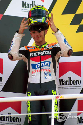 Valentino Rossi raises helmet to crowd